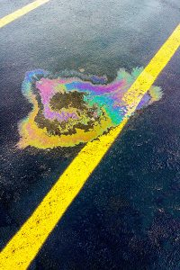 Monmouth County sealcoating protects against oil spills like shown on yellow lined parking space
